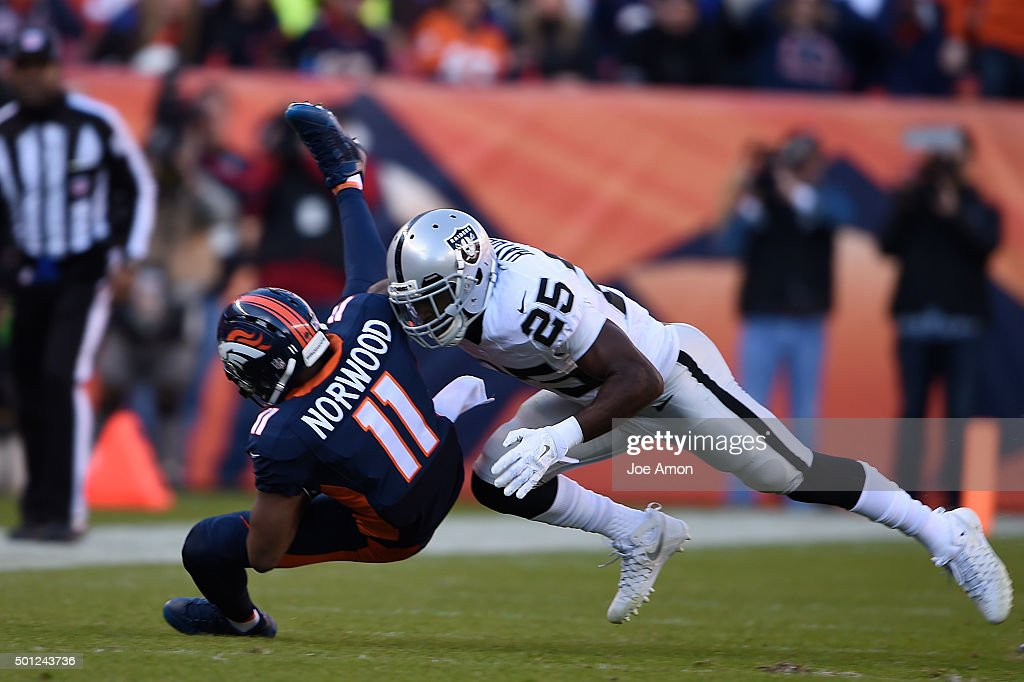 Jordan Norwood of the Denver Broncos is tackled by DJ Hayden of the Oakland Raiders in the first quarter The Broncos played the Oakland Raiders at...