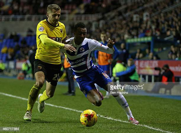 Jordan Obita of Reading holds off pressure from Almen Abdi of Watford during the Sky Bet Championship match between Reading and Watford at Madejski...