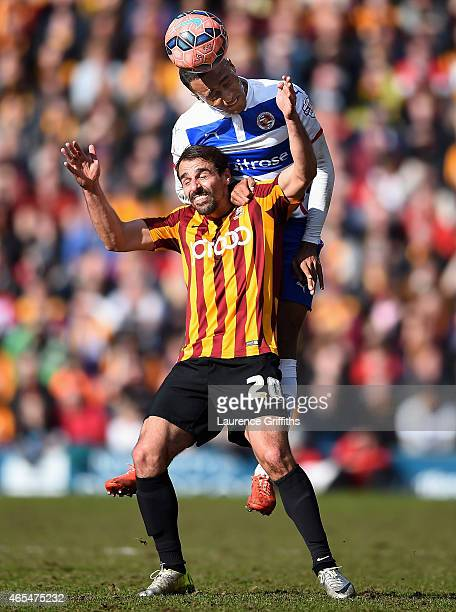 Jordan Obita of Reading rises above Filipe Morais of Bradford City to win a header during the FA Cup Quarter Final match between Bradford City and...