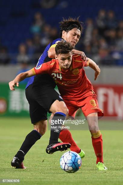 Jordan O'Doherty of Adelaide United competes for the ball against Yasuhito Endo of Gamba Osaka during the AFC Champions League Group H match between...