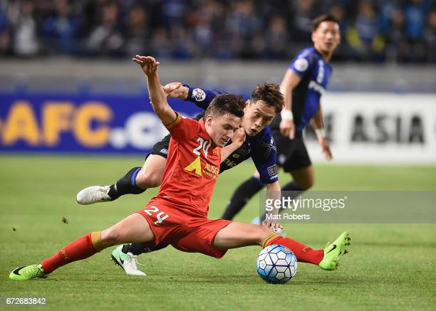 Jordan O'Doherty of Adelaide United competes for the ball against Oh JaeSuk of Gamba Osaka during the AFC Champions League Group H match between...