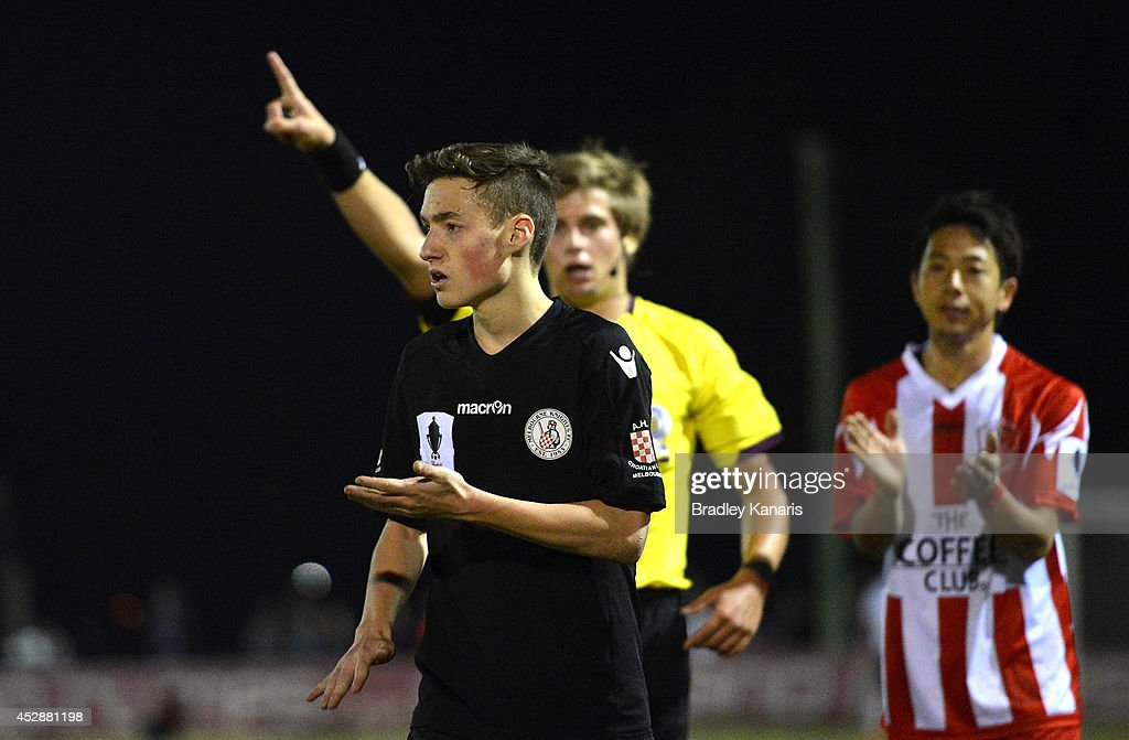 Jordan O'Doherty of the Knights is given a red card by referee <a gi-track='captionPersonalityLinkClicked' href=/galleries/search?phrase=Alex+King&family=editorial&specificpeople=213787 ng-click='$event.stopPropagation()'>Alex King</a> during the FFA Cup match between Olympic FC and Melbourne Knights at Goodwin Park on July 29, 2014 in Brisbane, Australia.