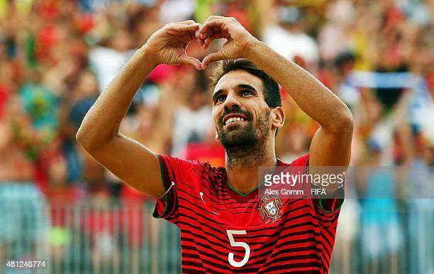 Jordan of Portugal celebrates his team's first goal during the FIFA Beach Soccer World Cup Portugal 2015 Semifinal match between Portugal and Russia...