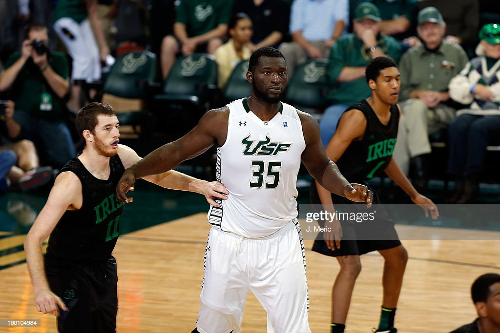 Jordan Omogbehin #35 of the South Florida Bulls calls for the ball as Garrick Sherman #11 of the Notre Dame Fighting Irish defends during the game at the Sun Dome on January 26, 2013 in Tampa, Florida.
