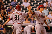 Jordan Pacheco and Nick Ahmed of the Arizona Diamondbacks celebrate after scoring on a two RBI single by Ender Inciarte of the Arizona Diamondbacks...