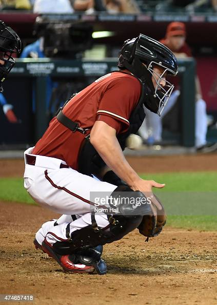 Jordan Pacheco of the Arizona Diamondbacks blocks a pitch in the dirt with his chest protector during the fifth inning against the Chicago Cubs at...