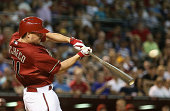 Jordan Pacheco of the Arizona Diamondbacks hits a RBI single against the Los Angeles Dodgers during the fourth inning of the MLB game at Chase Field...