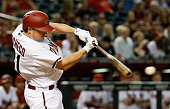Jordan Pacheco of the Arizona Diamondbacks hits a single against the San Francisco Giants during the seventh inning of the Opening Day MLB game at...