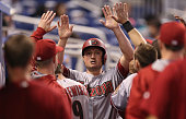 Jordan Pacheco of the Arizona Diamondbacks in the dugout after scoring during the second inning of the game against the Miami Marlins at Marlins Park...