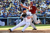 Jordan Pacheco of the Arizona Diamondbacks is out at home plate in the 13th inning against JP Howell of the Los Angeles Dodgers at Dodger Stadium on...