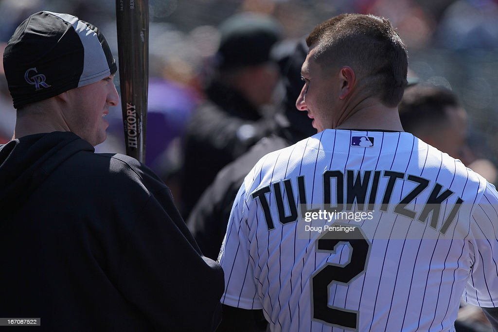 Jordan Pacheco #15 of the Colorado Rockies and Troy Tulowitzki #2 of the Colorado Rockies talk on the bench as they face the New York Mets at Coors Field on April 18, 2013 in Denver, Colorado. The Rockies defeated the Mets 11-3.