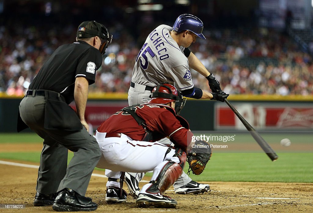 Jordan Pacheco #15 of the Colorado Rockies bats against the Arizona Diamondbacks during the MLB game at Chase Field on April 28, 2013 in Phoenix, Arizona. The Diamondbacks defeated the Rockies 4-2.