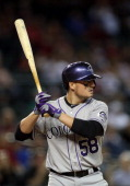 Jordan Pacheco of the Colorado Rockies bats against the Arizona Diamondbacks during the MLB game at Chase Field on April 29 2014 in Phoenix Arizona...