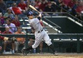 Jordan Pacheco of the Colorado Rockies bats against the Arizona Diamondbacks during the MLB game at Chase Field on April 30 2014 in Phoenix Arizona...