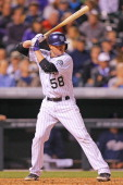 Jordan Pacheco of the Colorado Rockies bats against the San Diego Padres at Coors Field on May 17 2014 in Denver Colorado