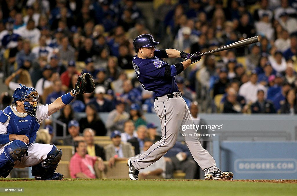 Jordan Pacheco #15 of the Colorado Rockies bats in the sixth inning during the MLB game against the Los Angeles Dodgers at Dodger Stadium on April 30, 2013 in Los Angeles, California. The Dodgers defeated the Rockies 6-2.