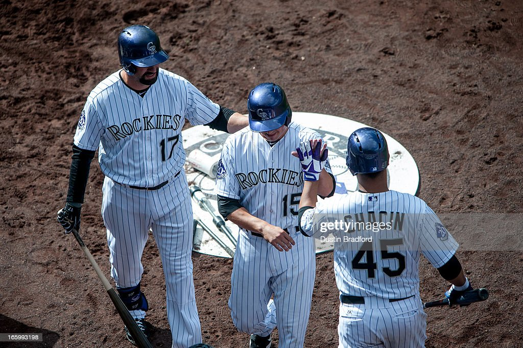 Jordan Pacheco #15 of the Colorado Rockies celebrates a run scored with teammates Todd Helton #17 and Jhoulys Chacin #45 in the sixth inning against the San Diego Padres at Coors Field on April 7, 2013 in Denver, Colorado. The Rockies beat the Padres 9-1.