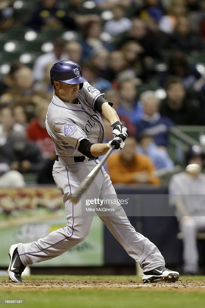 Jordan Pacheco #15 of the Colorado Rockies doubles in the top of the fifth inning against the Milwaukee Brewers at Miller Park on April 3, 2013 in Milwaukee, Wisconsin.