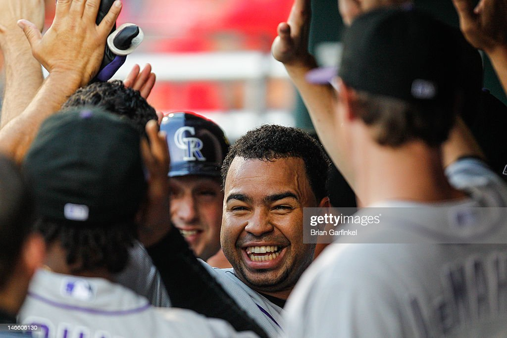 Jordan Pacheco #22 of the Colorado Rockies is greeted by teammates in the dugout after scoring a run in the second inning of the game against the Philadelphia Phillies at Citizens Bank Park on June 20, 2012 in Philadelphia, Pennsylvania.