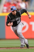 Jordan Pacheco of the Colorado Rockies runs the bases against the Cincinnati Reds at Great American Ball Park on May 10 2014 in Cincinnati Ohio