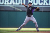 Jordan Pacheco of the Colorado Rockies warms up prior to the game against the Cleveland Indians at Progressive Field on May 30 2014 in Cleveland Ohio
