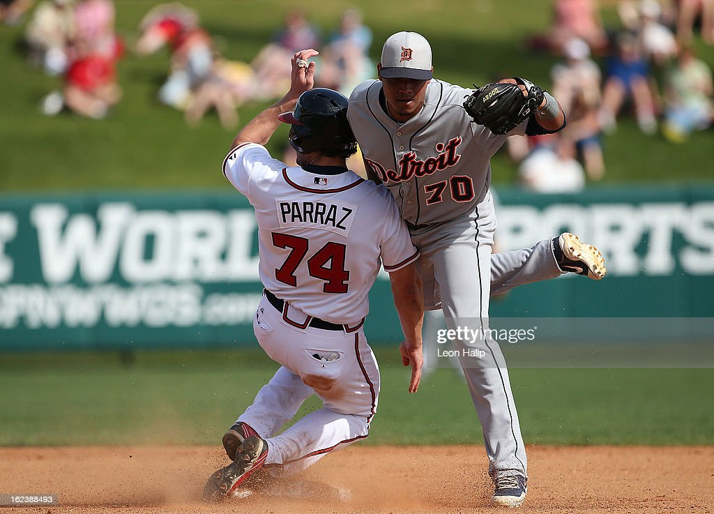 Jordan Parraz #74 of the Atlanta Braves breaks up the double play as <a gi-track='captionPersonalityLinkClicked' href=/galleries/search?phrase=Argenis+Diaz&family=editorial&specificpeople=4920884 ng-click='$event.stopPropagation()'>Argenis Diaz</a> #70 of the Detroit Tigers attempts the tag during the game on February 22, 2013 in Lake Buena Vista, Florida. The Tigers defeated the Braves 2-1.