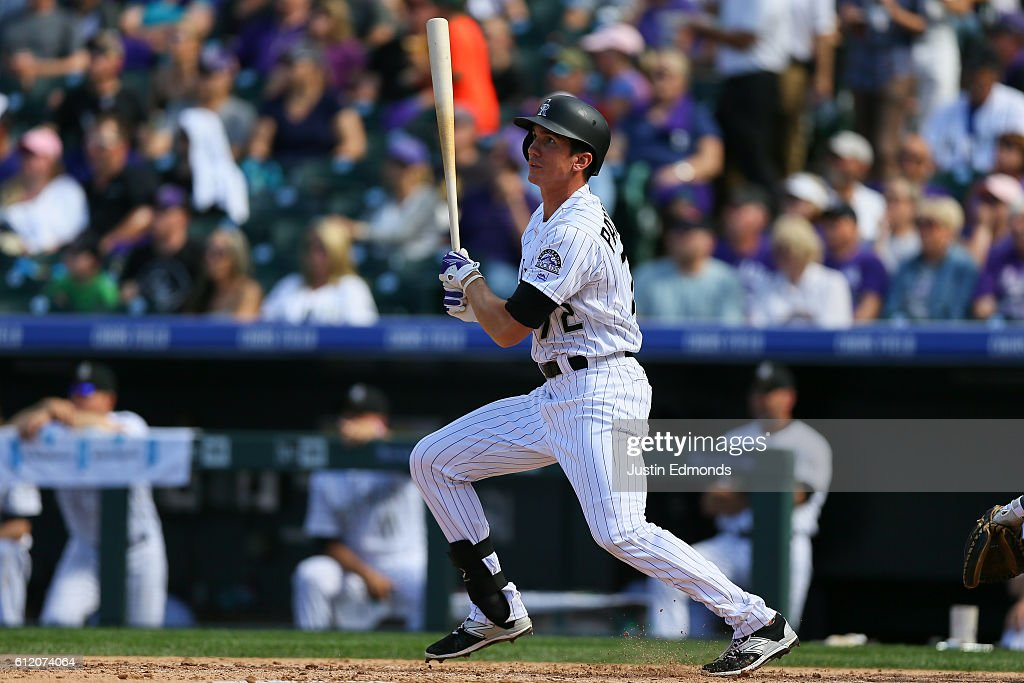 Jordan Patterson #72 of the Colorado Rockies watches his RBI double during the fifth inning against the Milwaukee Brewers at Coors Field on October 2, 2016 in Denver, Colorado.
