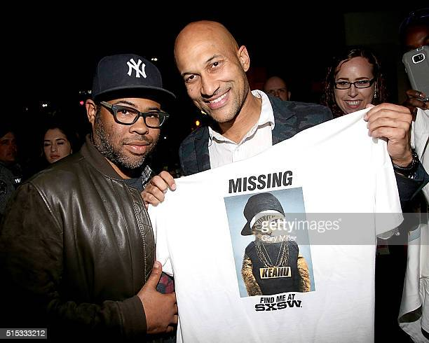 Jordan Peele and KeeganMichael Key pass out Tshirts promoting their new film 'Keanu' at a special screening at the Paramount Theater during the South...