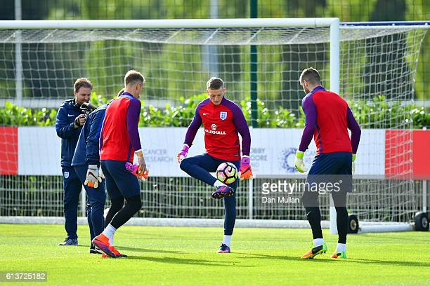 Jordan Pickford in action with Joe Hart and Fraser Forster during an England training session at the Tottenham Hotspur training ground on October 10...