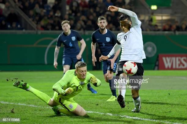 Jordan Pickford of England challenges Davie Selke of Germany during the U21 international friendly match between Germany and England at BRITAArena on...