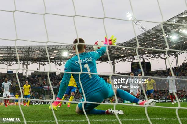 Jordan Pickford of England saves a penalty shot from Linus Wahlqvist of Sweden during the UEFA European Under21 Championship match between Sweden and...