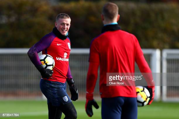 Jordan Pickford of England taks to Joe Hart of England during an England training session ahead of the International Friendly match between England...