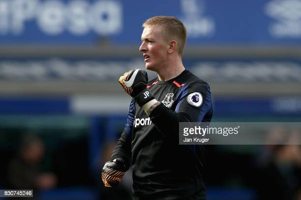 Jordan Pickford of Everton celebrates victory after the Premier League match between Everton and Stoke City at Goodison Park on August 12 2017 in...