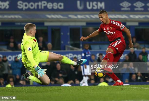 Jordan Pickford of Everton fouls Richarlison de Andrade of Watford and a penalty is awarded during the Premier League match between Everton and...