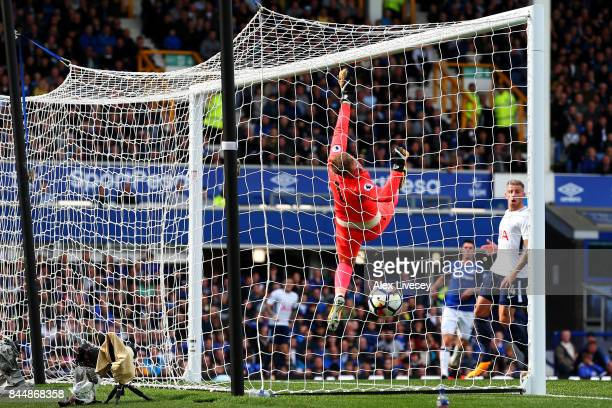 Jordan Pickford of Everton is beaten as Harry Kane of Tottenham Hotspur scores his sides first goal during the Premier League match between Everton...