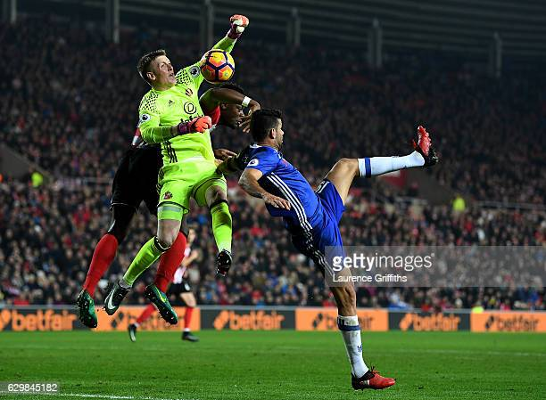 Jordan Pickford of Sunderland and Diego Costa of Chelsea compete for the ball during the Premier League match between Sunderland and Chelsea at...