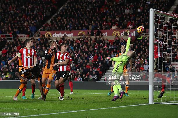 Jordan Pickford of Sunderland saves a header from Dieumerci Mbokani of Hull City during the Barclays Premier League match between Sunderland and Hull...