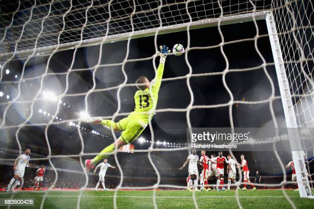 Jordan Pickford of Sunderland stretches to make a save during the Premier League match between Arsenal and Sunderland at Emirates Stadium on May 16...