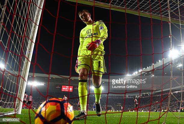 Jordan Pickford of Sunderland walks to the net to pick up the ball after Chelsea's first goal during the Premier League match between Sunderland and...