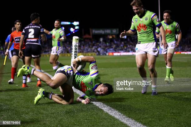 Jordan Rapana of the Raiders celebrates scoring a try during the round 22 NRL match between the Cronulla Sharks and the Canberra Raiders at Southern...