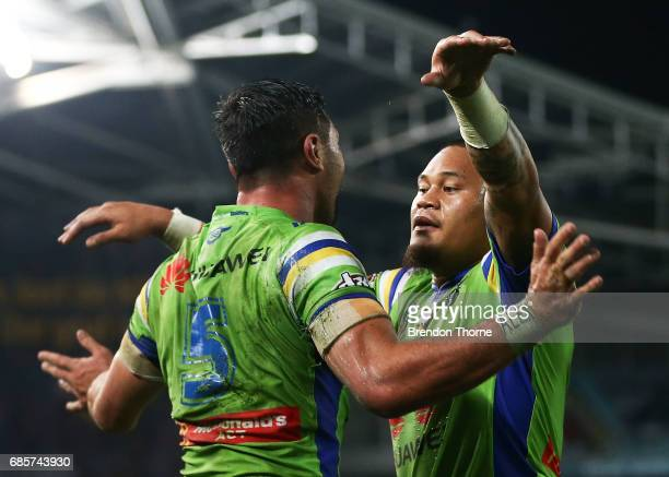 Jordan Rapana of the Raiders celebrates with team mate Joseph Leilua after scoring the winning try during the round 11 NRL match between the...