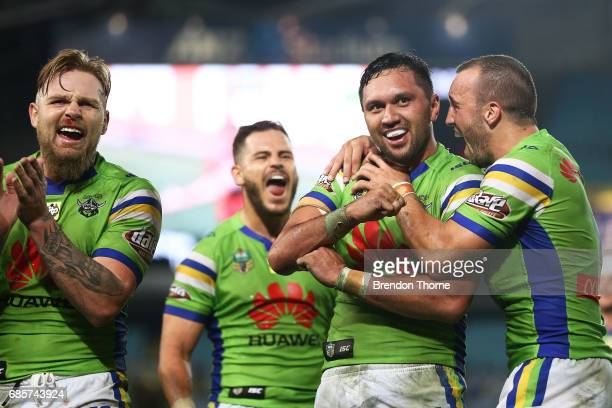 Jordan Rapana of the Raiders celebrates with team mates after scoring the winning try during the round 11 NRL match between the Parramatta Eels and...