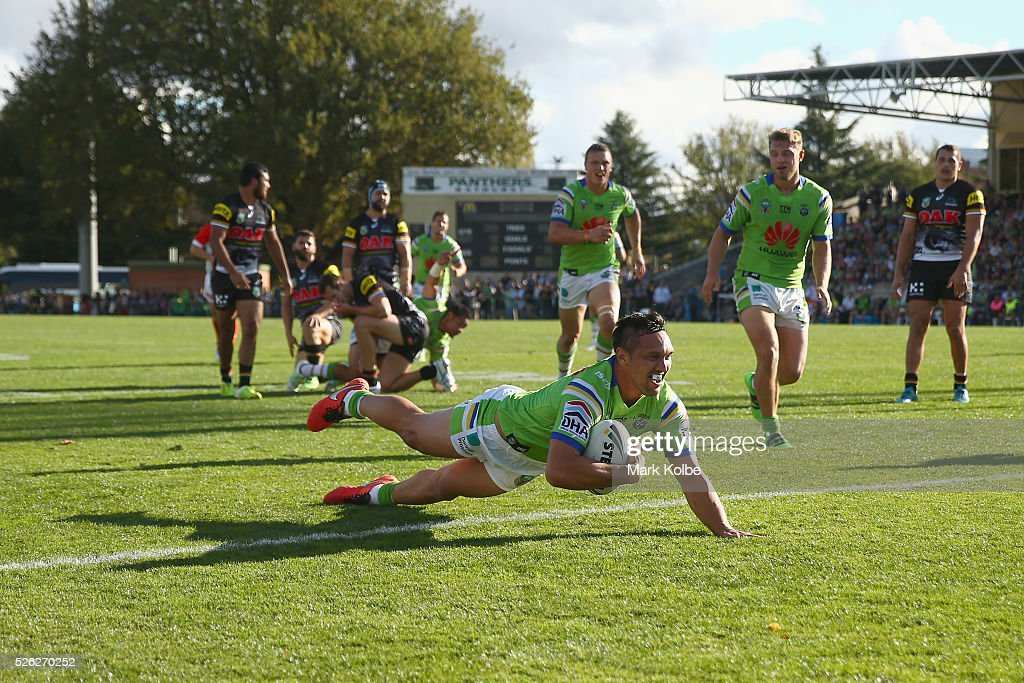 Jordan Rapana of the Raiders dives over to score a try during the round nine NRL match between the Penrith Panthers and the Canberra Raiders at Carrington Park on April 30, 2016 in Bathurst, Australia.