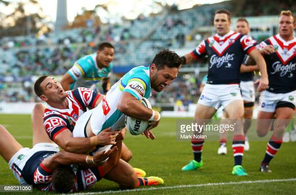 Jordan Rapana of the Raiders heads for the try line to score during the round 12 NRL match between the Canberra Raiders and the Sydney Roostrers at...