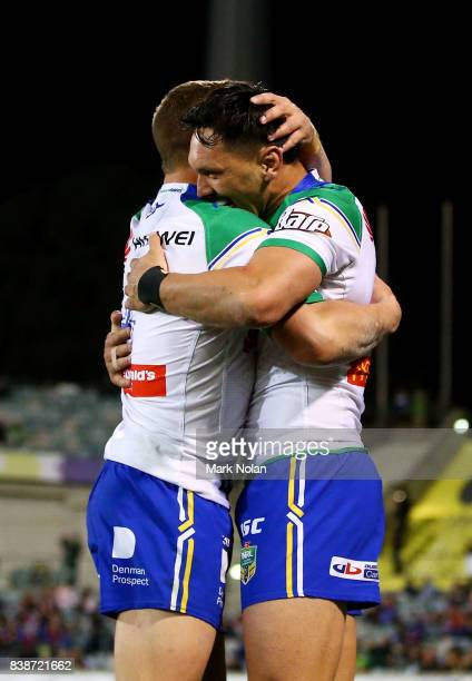 Jordan Rapana of the Raiders is congratulated after scoring during the round 25 NRL match between the Canberra Raiders and the Newcastle Knights at...