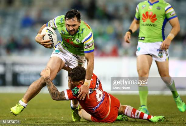Jordan Rapana of the Raiders is tackled during the round 19 NRL match between the Canberra Raiders and the St George Illawarra Dragons at GIO Stadium...