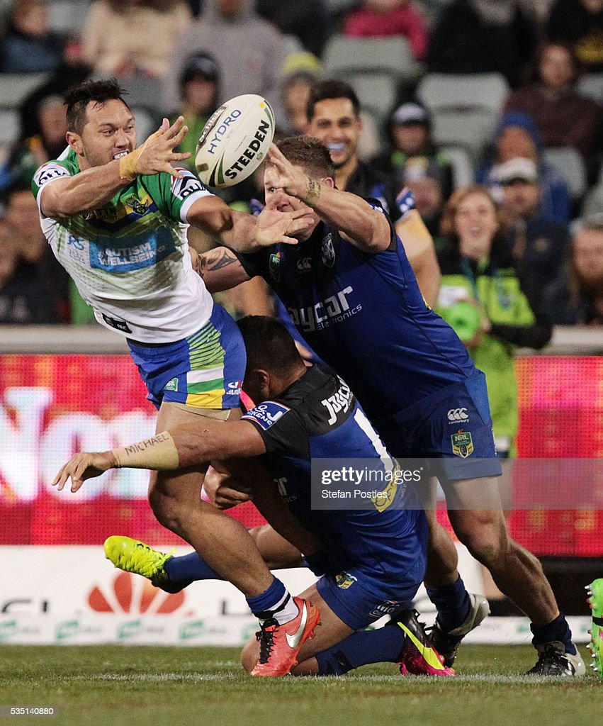 Jordan Rapana of the Raiders off loads the ball during the round 12 NRL match between the Canberra Raiders and the Canterbury Bulldogs at GIO Stadium on May 29, 2016 in Canberra, Australia.
