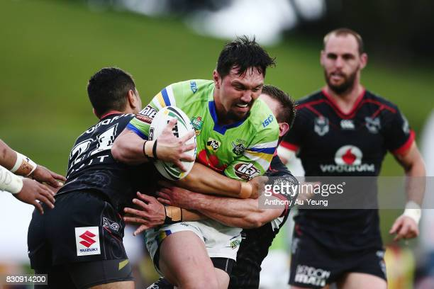Jordan Rapana of the Raiders on the charge against Mafoa'aeata Hingano of the Warriors during the round 23 NRL match between the New Zealand Warriors...