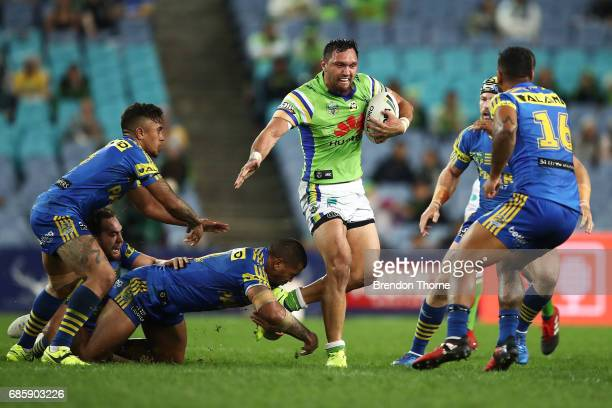 Jordan Rapana of the Raiders runs the ball during the round 11 NRL match between the Parramatta Eels and the Canberra Raiders at ANZ Stadium on May...