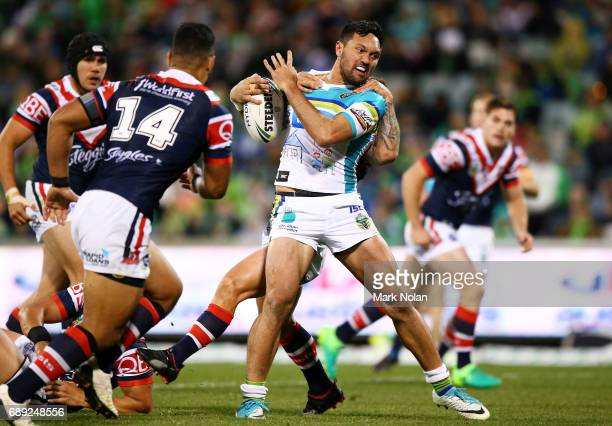 Jordan Rapana of the Raiders runs the ball during the round 12 NRL match between the Canberra Raiders and the Sydney Roostrers at GIO Stadium on May...